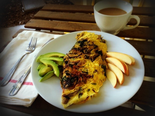 An omelette filled with healthy greens and veggies.
