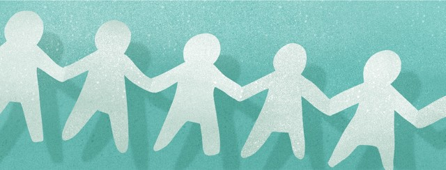 paper cutouts of people holding hands