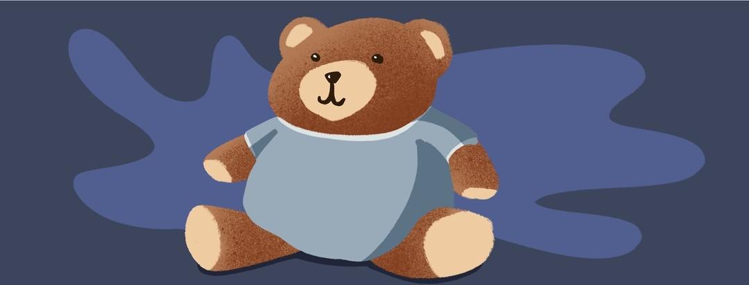 teddy bear wearing a hospital gown
