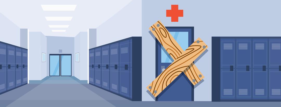 school hallway with boards over the nurse door