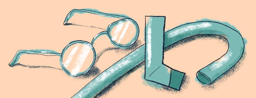 inhaler next to glasses and a cane