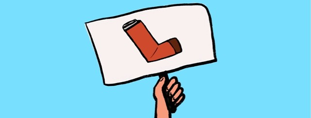 A hand holding up a sign with a picture of a red inhaler.