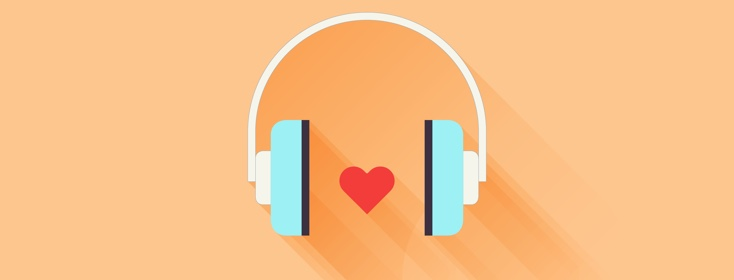Over ear headphones with an illustrated heart in between the speakers.