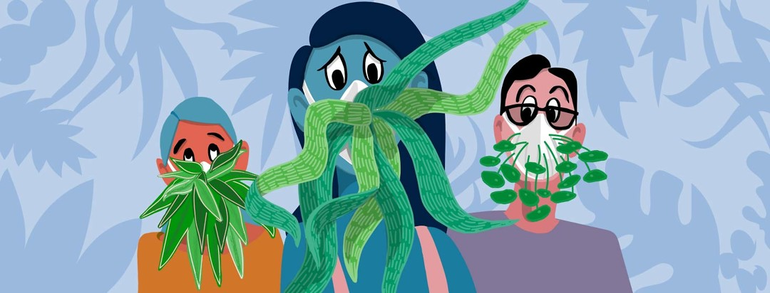 three people wearing masks made of various plants