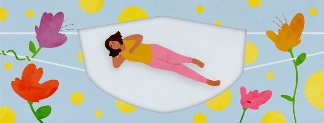 a woman laying in the cut out of a mask that is keeping the pollen away
